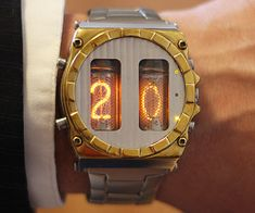 Set yourself apart from everyone wearing an iWatch with this Nixie tube watch. Each piece is handmade from milled pieces of brass and aluminum and complemented with two IN-16 Nixie tubes that display the hour, seconds, and remaining battery life.