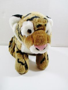 "Circo Plush Bengal Tiger Cub. Soft 15"" Stuffed Animal. This is a well cared for plush animal that remains in great condition with minor to no signs of wear. Brown w/ Black Stripes. ..... Visit all of our online locations..... www.stores.ebay.com/ourfamilygeneralstore ..... www.bonanza.com/booths/Family_General_Store ..... www.facebook.com/OurFamilyGeneralStore"