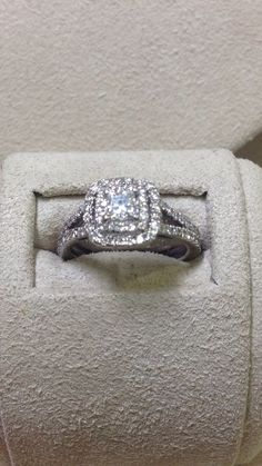 .20ct Princess Cut Diamond (SI1I) surrounded by .80ctw Diamonds. Gorgeous double halo engagement ring. ( Similar Ring retails for $2900 @ Zales and Jared) Has been professionally cleaned and polished- a truly beautiful ring.