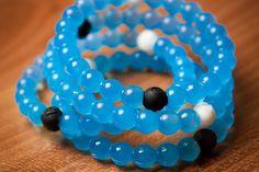 The blue Lokai bracelet celebrates #Charity:Water
