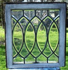 leaded glass window - I want windows like these on either side of my chimney with some built in bookcases underneath.