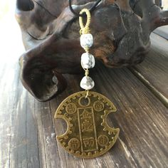 Custom Gold wire wrap Chinese Coin with White Howlite Stone by ignitejewelsdesign on Etsy