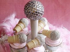 karaoke cupcakes!  24 vanilla cupcakes baked in silver or foil liners 24 plain doughnut holes 1 can (16 oz) plus 1 cup vanilla frosting 1 cup mini silver dragees or decorating sugars or sprinkles, 24 mini kids' ice cream cones, (Joy) Red food coloring, 24 pieces pink licorice pastels (Jelly Belly)     Read More http://www.ivillage.com/karaoke-cupcakes/3-r-313662#ixzz1gwtxv5B4