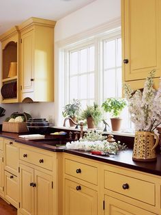 Refresh Your Kitchen with These Colorful Cabinetry Ideas Courageous Yellow: Feeling that natural wood-tone cabinetry would be too dark for their kitchen, especially during the minimal daylight of Midwestern winters, these homeowners chose cherry cabinets Yellow Kitchen Cabinets, Cherry Cabinets, Kitchen Cabinet Colors, Kitchen Cabinetry, Kitchen Redo, Kitchen Colors, New Kitchen, Kitchen Remodel, Kitchen Dining