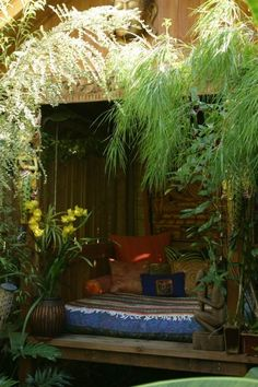 PERFECT IDEA for under our patio, scaled back a bit from the intense timber, greenery and boho style, but def luv the snuggley, secluded, private, fun and funky idea!!   Moon to Moon: bohemian garden
