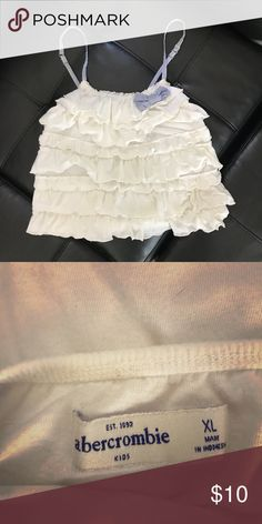 Abercrombie ruffle bow tank Worn a few times. Great condition with no flaws. Aits Abercrombie Kids size XL equivalent to size XS in adult. Abercombie Kids Tops Tank Tops