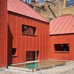 A courtyard house in west London by Henning Stummel Architects comprises a series of pavilions    Photos Timothy Soar    Tin House is located on a backland site in west London. Creating a secluded place was a priority, writes Henning Stummel Architects. Our response was to develop a low, inward-looking courtyard arrangement
