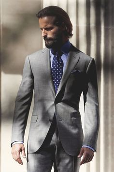 The tie makes suit stand out Polka dot blue tie
