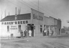 """During the days when Sandy was a rough western mining town, it's been said 17 or so saloons were strung out along Main Street and frequented by residents, travelers, and miners. At one time, Hans Nelson Bjork and Ole Nelson's """"Swede Saloon"""" was located here. In 1916 and in this site, the spontaneously named Damifino Saloon greeted the public. Then in 1930, Y. Martin Anderson, a meat cutter for 37 years, used the site to build his meat business."""