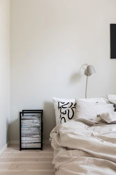 """From article """"In bed with Emilia Ilke"""" at Midnatthome.com. A modern artist's home. Midnatt's bedding Pebble and Artise in a great mix. Photo: Mikael Lundblad Closet Bedroom, Bedroom Decor, Bedroom Ideas, Scandinavian Style Bedroom, Cream Bedding, Inspirational Wall Art, Bedroom Styles, White Patterns, New Room"""