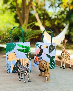 Send your little wild adventurers home with these colorful party bags featuring embellished leaf prints and cute animal friends. They're the perfect finishing touch to your safari/jungle themed party! Pack of 8 Size: 5 x inches Safari Party Favors, Safari Party Decorations, Girl Safari Party, Animal Themed Birthday Party, Jungle Theme Birthday, Zoo Animal Party, Party Animals, 2nd Birthday Party For Girl, Birthday Ideas