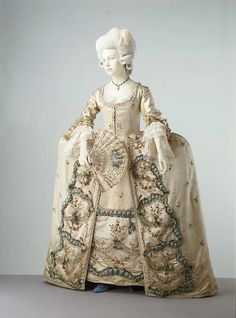 Sack back gown, French ca. 1775-1780 Silk satin, embroidered with chenille thread and ribbon, trimmed with satin, silk bobbin lace, feathers and raffia tassels, lined with silk and linen, hand-sewn