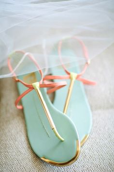 A pop of aqua and coral in your Summer sandals.