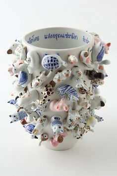 Designer Carla Peters covered every inch of this handmade vase in a collection of curiosities. No two are exactly alike.