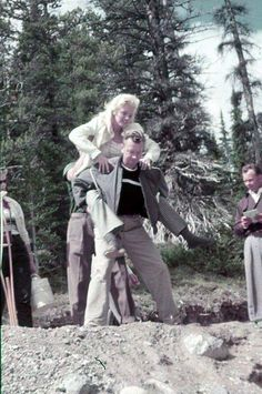 Marilyn being carried by her friend and make-up artist Allan 'Whitey' Snyder during the filming of River of No Return, 1953.