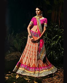 Pink and Rust heavy embroidered Lehenga   1. Pink and Rust heavy embroidered georgette Lehenga2. Hand work embroidery with mirror work3. Comes with matching dupatta and blouse4. Can be stitched upto size 42 inches
