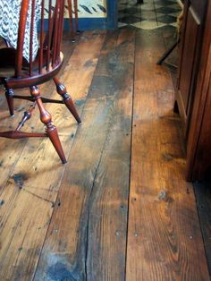 """The upper floors in most of the old houses in our area are finished in pine. The material is often covered over with carpet because it is a """"soft wood"""", not hardwood flooring. However, pine can have a beauty all its own, and we're always barefoot by the time we get upstairs anyway:"""
