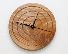This could be given big hands that increase its presence. Turned Wood Wall Clock of Red Elm by WoodArtForLiving on Etsy, $80.00