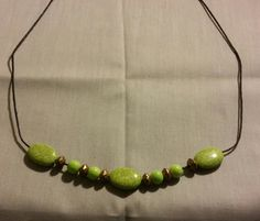 green turquiose beads with antique brass like beads