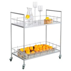 Serve hors d'oeuvres at your next soiree with this chic cart, or set it in the dining room as an impromptu home bar. Crafted of iron and showcasing 2 glass t...