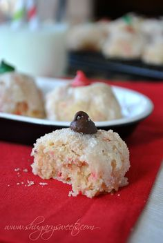 Grandma's Peppermint Puff Cookies- crunchy sugar coating around a soft peppermint center! Topped with a #chocolate chip. www.shugarysweets.com #holidaytreats
