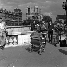 Menfolk in Paris do their part, 1955.