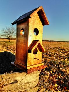 Birdhouse. 2 levels. Top level opened on all sides.