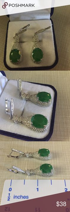 Green natural emerald earrings Very pretty green emerald white cz's dimension is 45x18mm gemstone size is 12x10mm heated and filled high quality with very slight inclusion approximately 1'1/2'long silver inlay to protect stones and prevent tarnish gorgeous design nwot very sparkle faceted stones Jewelry Earrings