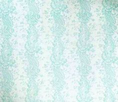 Pompadour Curtain Fabric Printed floral stripe in aqua on an off white cotton cloth.