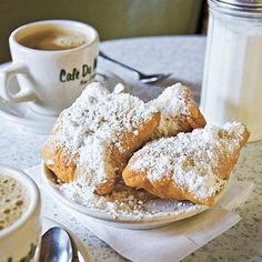Beignets & Chicory Coffee at the Cafe Du Monde in New Orleans.  You will get powdered sugar on your clothes.