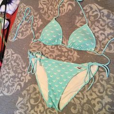 Swimsuit bikini!!! Holster triangle tini bikini! Bottoms come up high almost like high rise but definitely not low rise! Built in padding! Teal/baby blue color with white holister birds on it! Top is a small and bottoms are a medium! Hollister Swim Bikinis