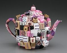 My goodness, Mad Hatter couldn't be happier! #altered #teapot