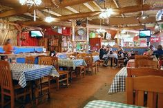 """Swadley's decor can be described as """"rustic Americana"""". Typical of many BBQ restaurants."""