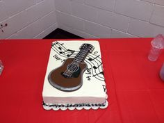 "Guitar candy plaque. Sheet Cake for 100. Actual notes to ""Happy Birthday"" for easy guitar. Fun stuff."