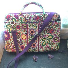 Vera Bradley laptop case Beautiful Vera Bradley case, very gently used! Comes with shoulder strap, and has 2 large side pockets. Measurements are: 17 inches across, 12 inches tall and about 19 inches across. This case is very sturdy, with some light padding on the inside, perfect for transporting! Vera Bradley Accessories Laptop Cases