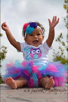 First birthday owl bodysuit with name, colorful tutu, and matching hair bow