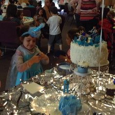 """The birthday girl in her Elsa dress we had made on Etsy and matching """"crown"""" I found at Walmart for a few dollars, I love a bargain!"""