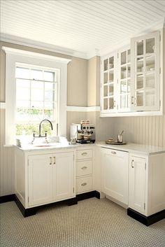 "BM ""ancient ivory"" on cabinets, ""crisp khaki"" on walls"