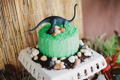 Caramel Mud Cake with cream cheese frosting, decorated with chocolate 'rocks; crushed Oreos and a plastic toy dinosaur