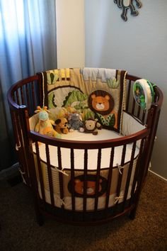 """I still like the cute neutral jungle theme and I am in love with these round cribs! I saw one in a furniture boutique and have wanted one ever since. I know it doesn't transition to their first """"bed"""" but who cares, beds can be cheap or made as built ins and you will have a really unique crib."""
