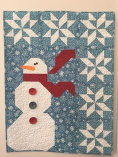 "Snowman wall hanging by Glo in the Dark Quilting.  ""Ho Ho Let it Snow"" pattern from Art to Heart patterns."