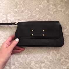 Kate Spade leather small clutch Perfect for going out and holding a cell phone and money. Used only once! kate spade Bags Clutches & Wristlets
