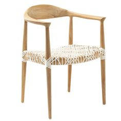 Artfully crafted of reclaimed teak wood, this chic arm chair's intricately laced seat offers a touch of breezy appeal.     Product: