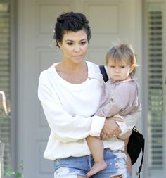 Kourtney Kardashian..hahah her daughter looks so pissed!!