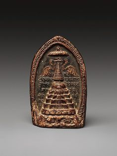 "Votive Plaque (Tsa Tsa) with a Stupa, 10th–11th century. Tibet. The Metropolitan Museum of Art, New York. Purchase, Rogers Fund, by exchange, 2011 (2011.43) | This molded clay votive plaque (""tsa tsa"") from Tibet presents a stepped stupa similar to those of north India. The ""ye dharma""  inscription in the background caries core the meaning of the Buddha's teachings.  This status as the Buddha's ""dharma body"" gives this plaque a very real relic significance.  #Buddhism"