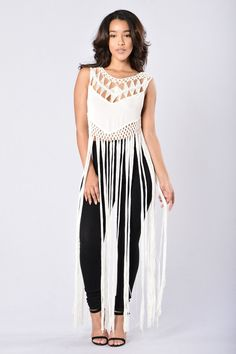 - Available in Off White - Crochet Embroidered Top - Long Fringe Bottom Detail - Sleeveless - Scoop Neckline - Loose Fit - 100% Acrylic