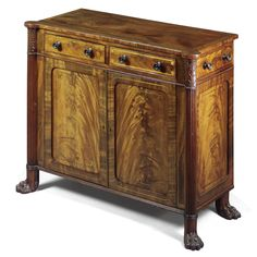 A Regency mahogany and brass-inlaid side cabinet circa 1815, in the manner of George Oakley