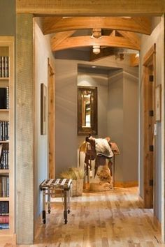Western saddle in an entry way. The perfect way to great guests as they arrive on the ranch. | Stylish Western Home Decorating