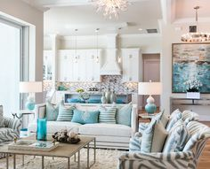 Grey interiors with white cabinets and turquoise decor Beautiful open floor plan…