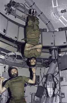 Space History Photo: Carr and Pogue in Skylab Two astronauts humorously demonstrate zero-gravity during the 1974 Skylab 4 mission. Credit: NASA